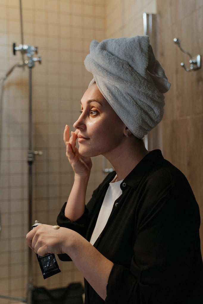 Woman Learning How To Apply Moisturizer On Face