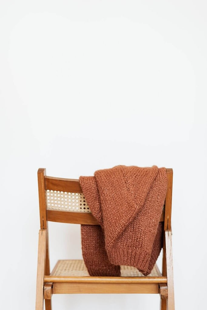 Sweater Hanging On Chair